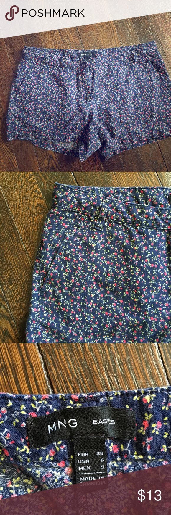 Mango Floral Shorts Cute floral printed shorts. Light cotton material. Size 6. Pre loved. No holes, stains. Or wear spots. Mango Shorts