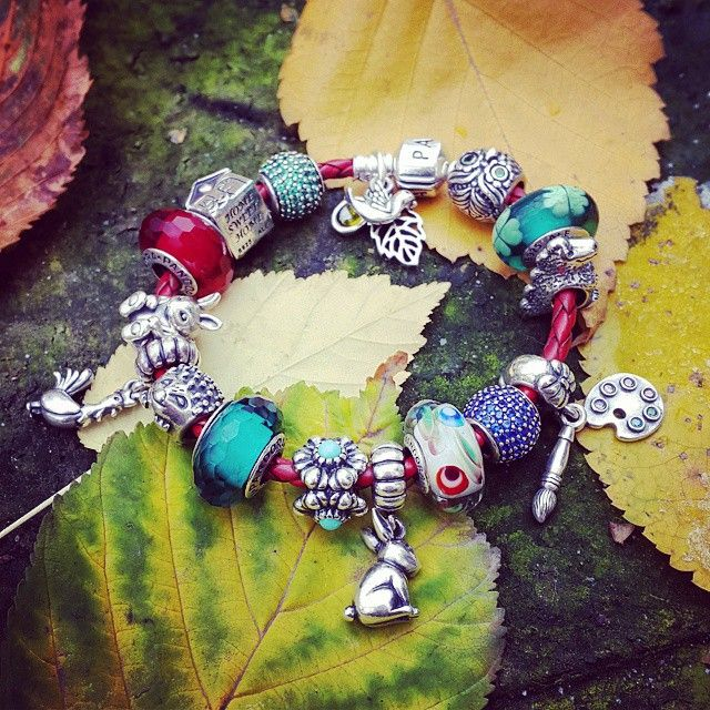 PAANDORA. Interesting Red Leather Bracelet with Blue and Green Charms.