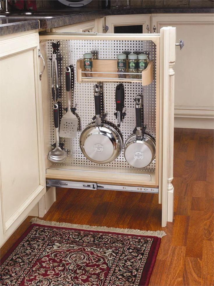 "6"" Base Filler with Stainless Steel Panel as well as an assortment of hooks and pegs. Simply install this product between two adjacent cabinets and add a decorative filler front to make your decorative filler a functional pull-out organizer."