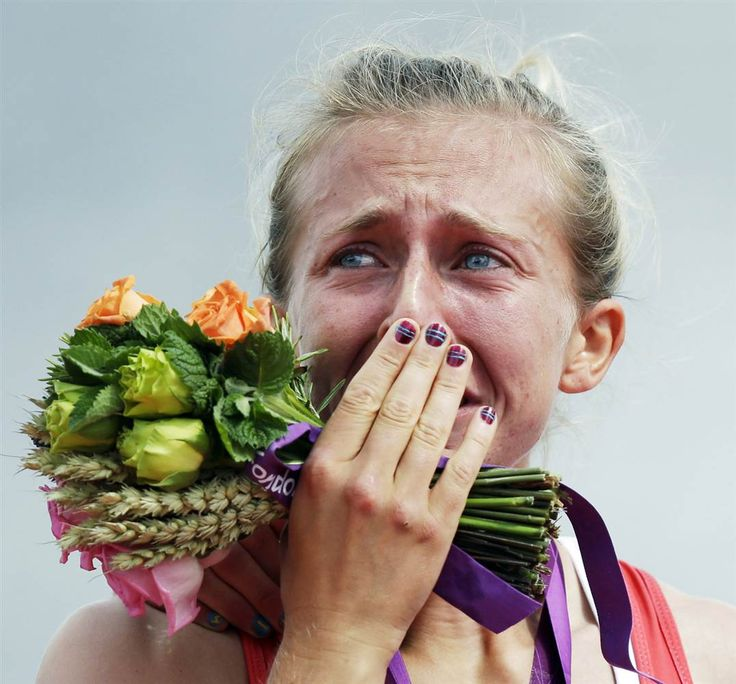 This picture makes me cry...Katherine Copeland cries during award ceremony for rowing.