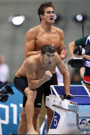 The Men Cheer Michael Phelps and teammate Nathan Adrian cheer on their