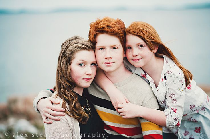 posing for families with teenagers, poses for families with older kids, family photography pose   ocean, water, newfoundland, photographer