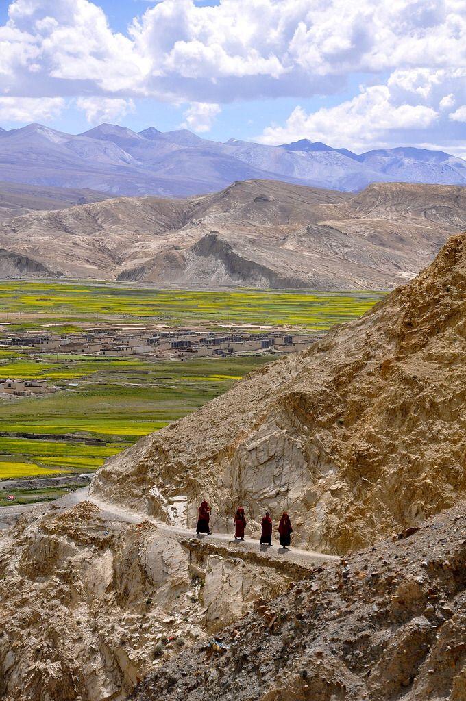 Monks walking in the Tibetan mountains