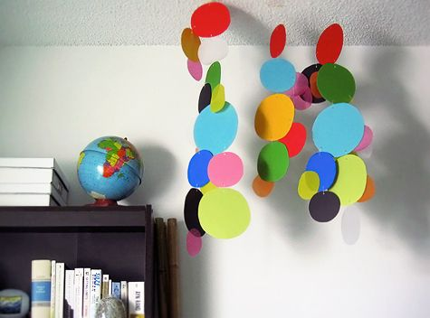 This would be a fun way to add some color to the usually drab kids' homes. The kids could cut out the circles...could hang from the ceiling or the top bunk.