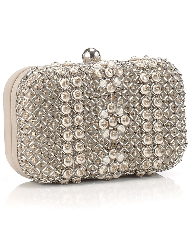 loving hard case clutches at the moment as a nice juxtaposition to my soft vintage dress