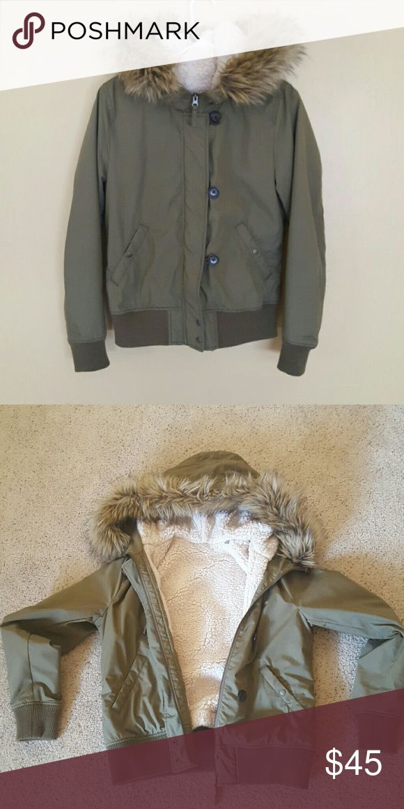 Uniqlo Women's Military Hooded Jacket Water repellent jacket with a convenient fleece removable liner and faux fur hood. High collar zips to the top and features a button closure. Worn only once, like new. Uniqlo Jackets & Coats