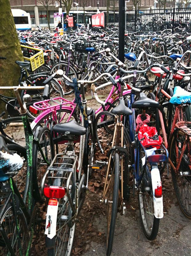 Bikes in Utrecht,The Netherlands.People keep their bikes here to catch the train to go to work.What a mess,uh?