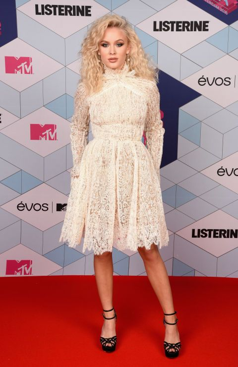Music stars are gathering in Rotterdam, Netherlands for the 2016 MTV Europe Music Awards. Zara Larrson looks stuns in a unique, white dress.