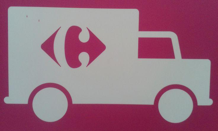 Valor Denotado: Vehículo-Camión Valor COnnotado: Reparto a domicilio de la empresa Carrefour.