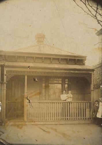 Mother Holding Baby on Front Verandah, Port Melbourne, 1911
