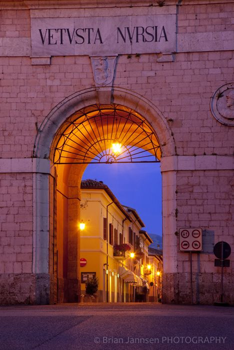 Twilight at the entry gate to Norcia, Umbria Italy