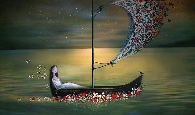 Mujer en una barca con flores navegando