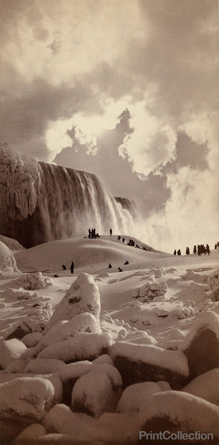 People on snow-covered ice at the base of the frozen American Falls, Niagara Falls, New York photographed by George Barker in 1883.
