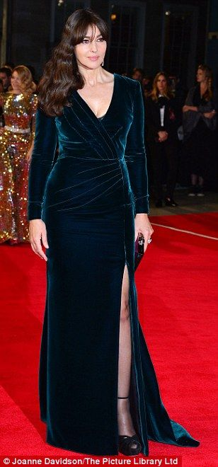 Picture perfect: The 51-year-oldwas the envy of all in a plunging emerald velvet gown whic...