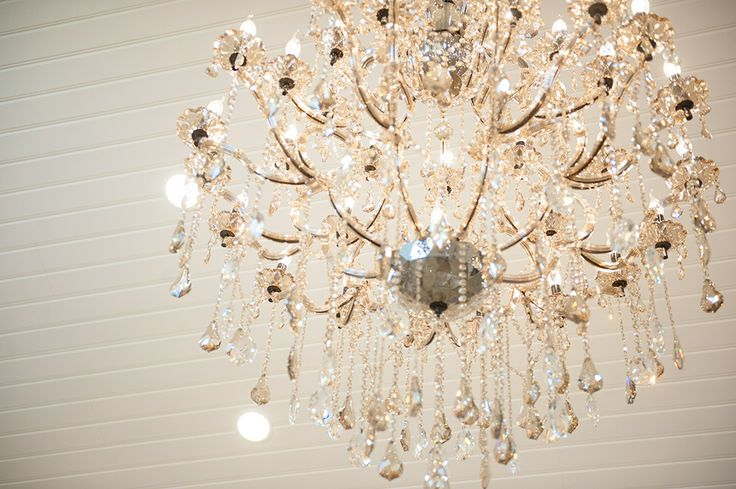Crystal chandeliers deck the halls of the new reception room!
