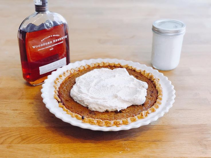 Homemade Bourbon Pumpkin and Butternut Squash Pie with spiced bourbon whipped cream. #happythanksgiving