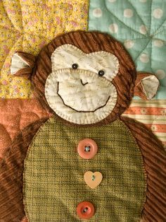 One monkey on baby quilt.    @Gabriela Schuetze @Sherree Schuetze @Kaitlin Schuetze ... This makes me think of Aiden! Although, unless a wall hanging, I wouldn't put buttons on a baby quilt! #chokinghazard