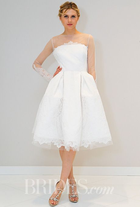 Brides.com: . Knee-length dress with lace detailing and illusion neckline. Randi Rahm Spring 2016.