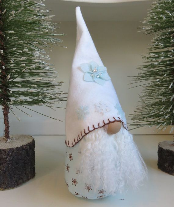 You are looking at a handmade Tomte, also known as a Swedish Gnome or Nisse. He would make a wonderful addition to your home or a great gift