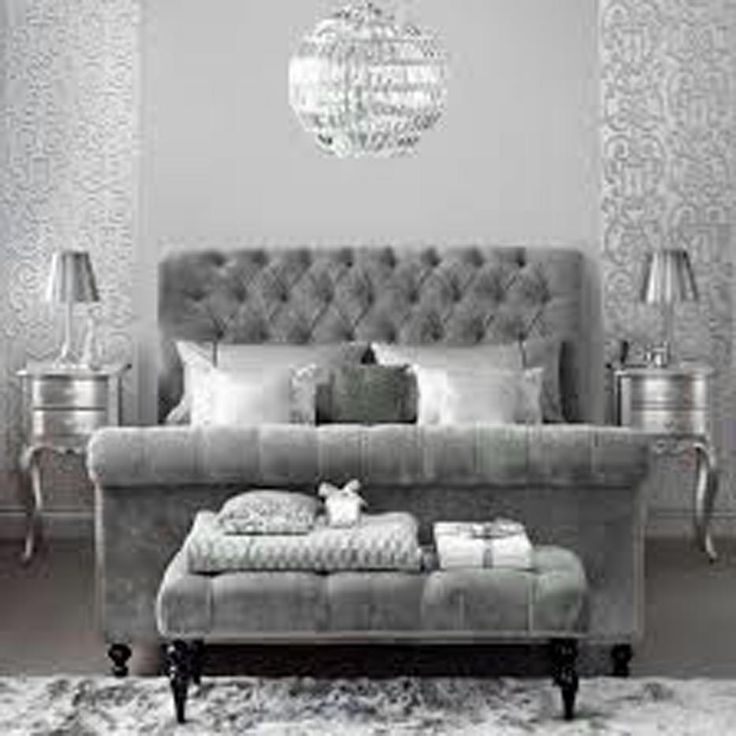 Glamorous Pewter Bedroom With A Velvet Headboard, Footstool, Metallic  Wallpaper And Glass Chandelier