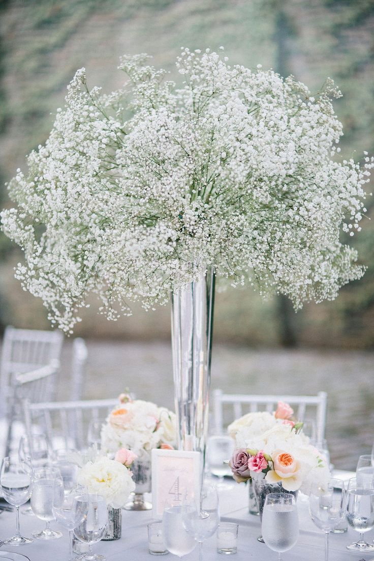 Picture Of a wood slice with greenery, baby's breath and ...