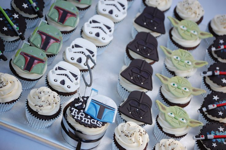Star Wars Cupcakes - Star Wars characters cut with a set of four cookie cutters from a high street store, light sabres modelled by hand. I made a large personalised cupcake for the birthday boy with his favourite character on - the number is a sparkler.
