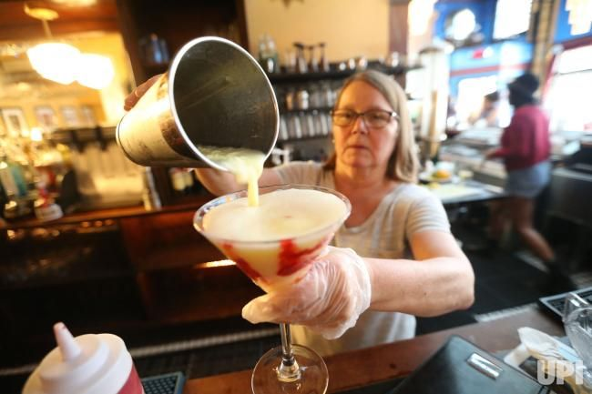 Barbara Schulz, General Manager of the Fountain on Locust, pours a rasberry lemondrop ice cream martini on National Ice Cream Day in St.…