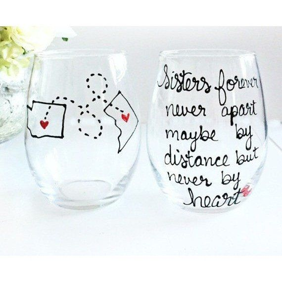 Perfect birthday gift for your sister or sister moving away gift! Sisters forever never apart maybe by distance but never by heart is hand painted on the stemless wine glass with your sisters state and your state or country.  Click to see more awesome long distance gift for everyone!