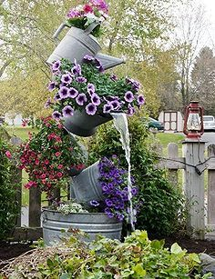 annie s galvanized tipsy pots, container gardening, flowers, gardening, outdoor living, ponds water features, repurposing upcycling, Add a pump and flowers
