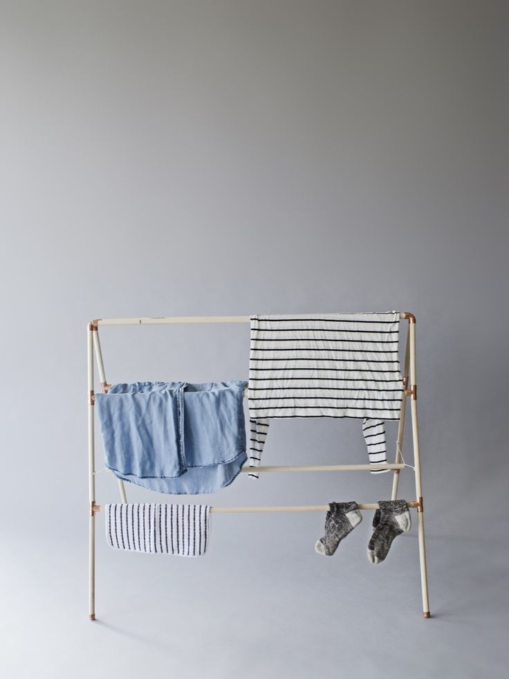A clothes drying rack is a fantastic asset to have in your laundry room. You don't have to be a master craftsman to make this minimal DIY drying rack.
