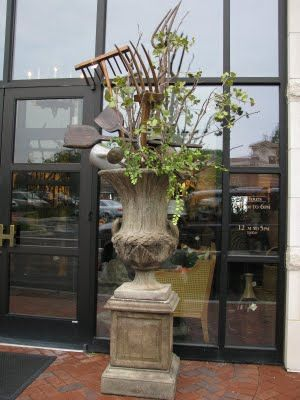 a pretty urn & pedestal for gardening buffs - fill with greenery & old garden tools!