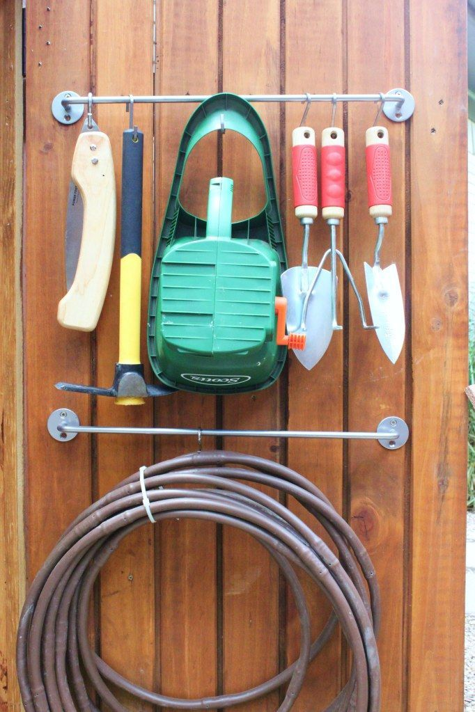 Make better use of your shed's doors by hanging everything from spades to the garden hose on a towl bar.