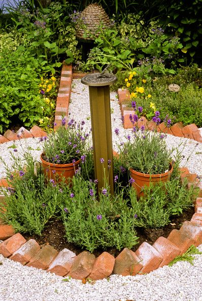 Garden. that is an interesting way to lay brick for edging around a garden bed.