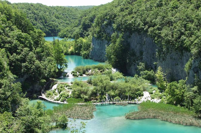 Private Tour: Plitvice Lakes National Park Day Trip from Dubrovnik 			Discover the breathtaking natural beauty of the UNESCO-listed Plitvice Lakes National Park on a private day trip from Dubrovnik. With your very own guide (if option is selected), stroll along scenic, woodland trails and absorb stunning views of the park's turquoise lakes, linked by crashing waterfalls and flowing streams. Opt for an electric boat ride (own expense) to get up close to the beautiful lakes, or ...