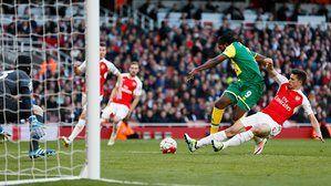Arsenal 1 Norwich City 0: Gabriel Paulista slides in to take the ball off Norwich striker Dieumerci Mbokani.