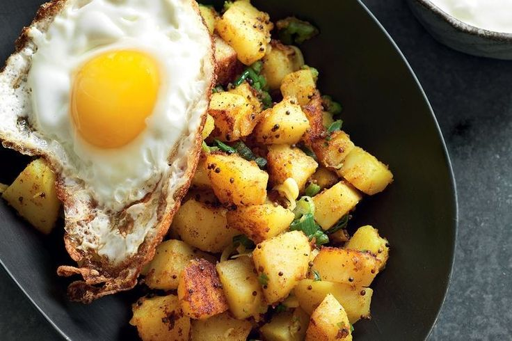 This turmeric potato dish is Bill Granger's modern, fresh take on fried egg and chips. Heartwarming and filling, works well as a small plate to share with friends.