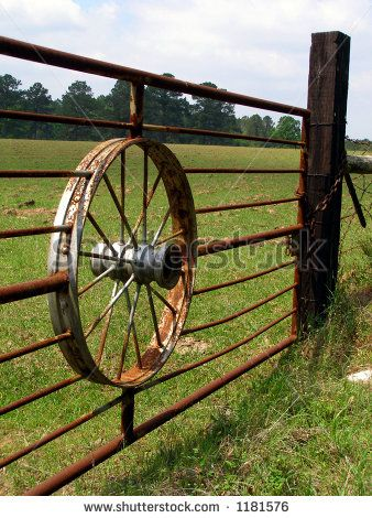 Wagon Wheel Gate Keywords: wagon, wheel, gate, hub, spokes, fence, post, farm, ranch, rustic, rusty, bars, rural, country, vintage by Roni L...
