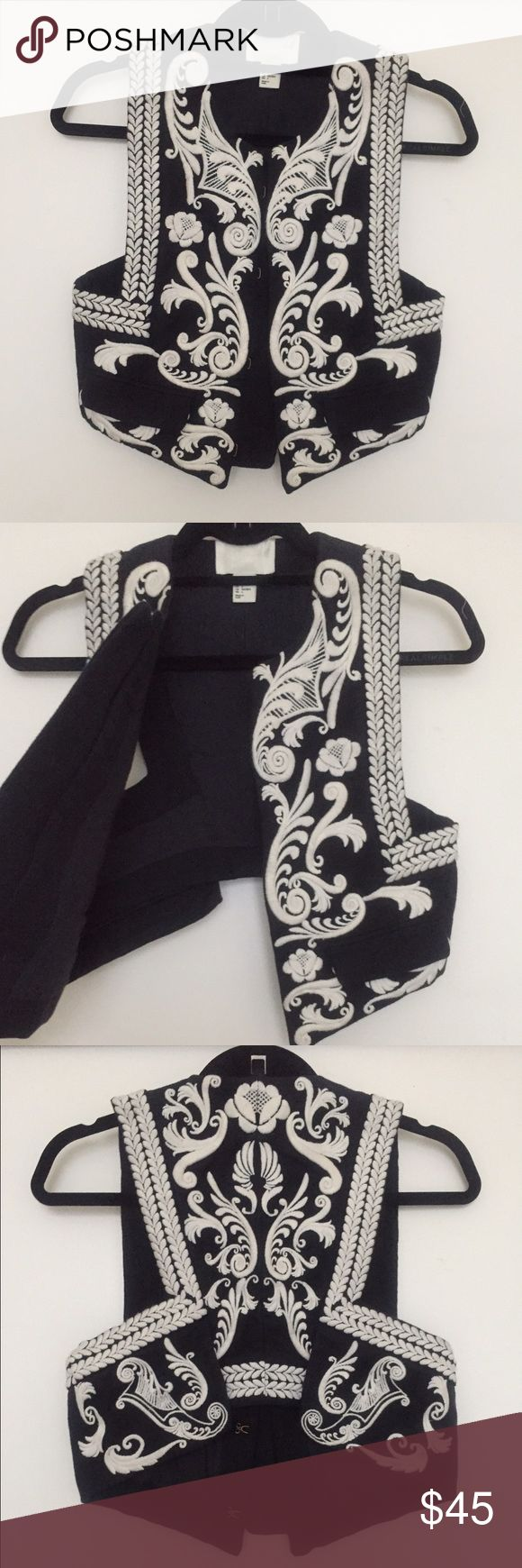 Black and white embroidered bolero vest. Black and white embroidered, bolero vest. Size 4/fits more like size 2. Never been worn. H&M Jackets & Coats Vests
