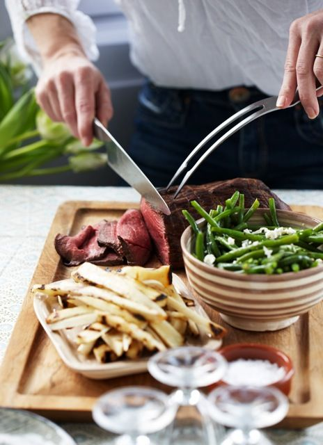 A family roast served with green beans in a hand painted ceramic bowl from tinekhome.