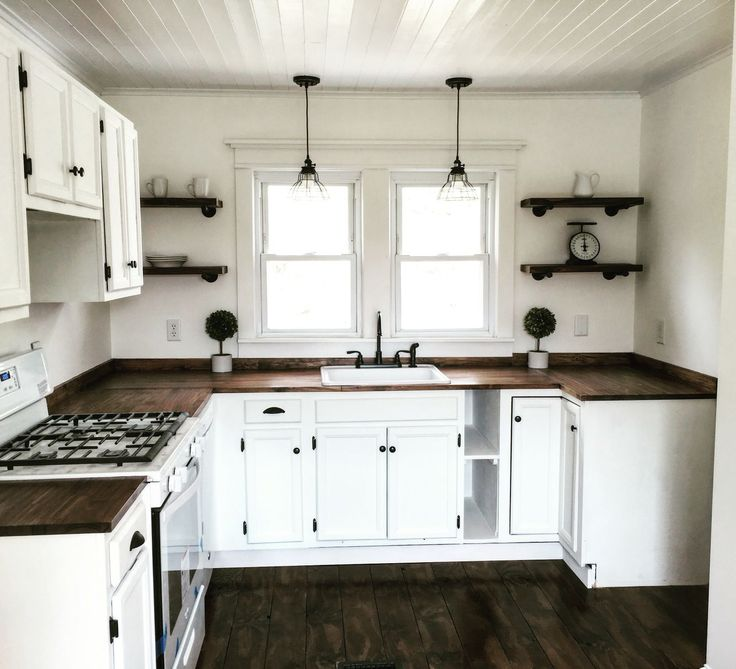 farmhouse kitchen on the cheap cabinets from craigslist painted with homemade chalk paint - Least Expensive Countertops