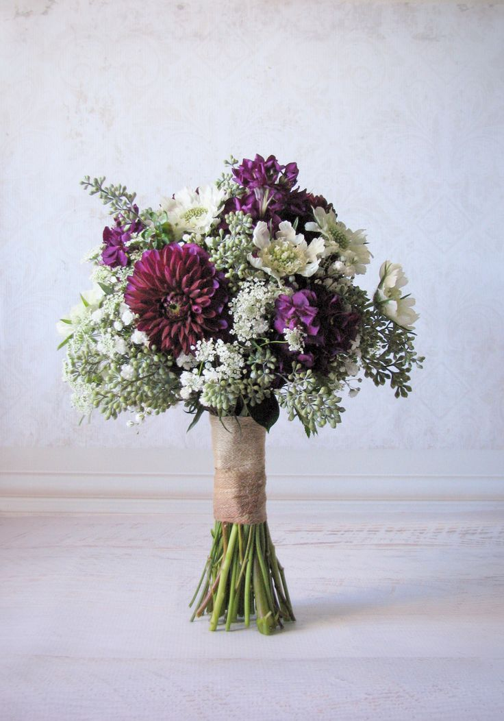 Purple and white autumn bridal bouquet of dahlias, stock, scabiosa, babies' breath, Queen Anne's lace, and seeded eucalyptus berries by Studio Bloom Iowa