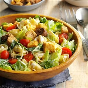 Tortellini Caesar Salad Recipe -This salad was served at a dear friend's baby shower by a health-conscious friend, who suggested the dressing be prepared with low-fat or fat-free ingredients. Either way, the creamy dressing has plenty of garlic flavor and coats the pasta, romaine and croutons nicely. -Tammy Steenbock, Sembach Air Base, Germany