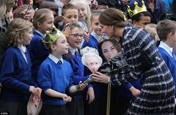 A young royal fan took his duties very seriously as he handed over a bunch of flowers to t...