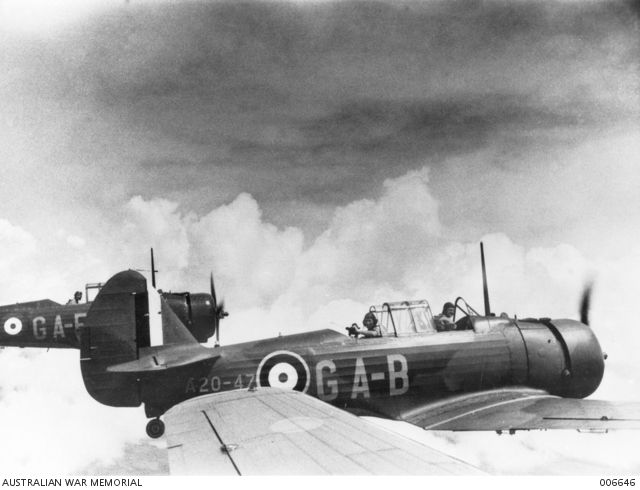 CAC Wirraway aircraft (left to right, code name GA-F and GA-B, serial no. A20-47) of No. 21 Squadron RAAF on a training flight over Singapore Island. The squadron is based at Sembawang airfield in ...