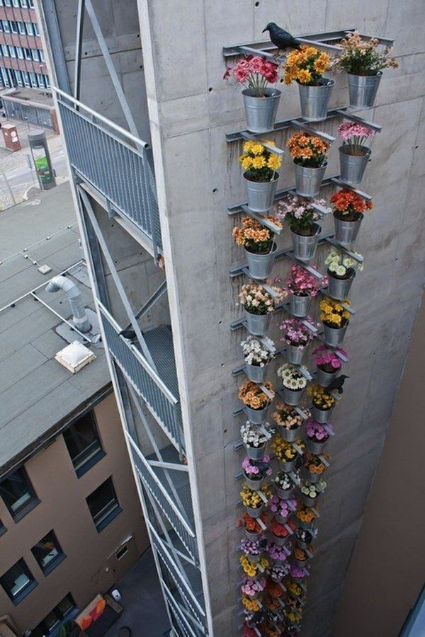 Tower of flowers. It allows plants to extend upward rather than grow along the surface of the garden. Doesn't take a lot of space and look so beautiful at the same time.