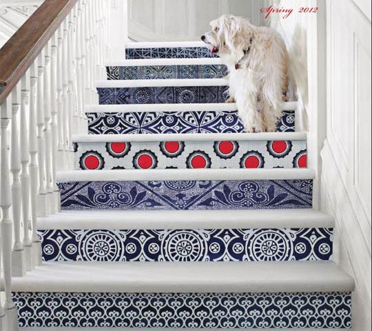A wallpaper project that is more manageable in scale: a staircase with mismatched (or cohesive) swatches of wallpaper applied to the base of each step.