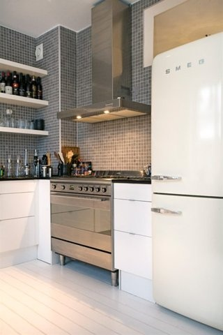 Modern kitchen with retro SMEG  It'd be cute! But I want my kitchen colors to be yellow, red, & teal. Cute, retro, modern, & just out there!(: