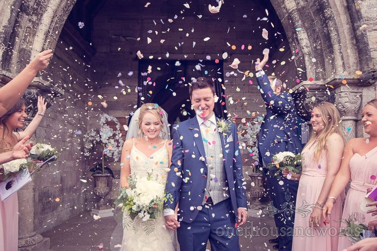 Wedding confetti photograph at Corfe Castle church wedding. Photography by one thousand words wedding photographers