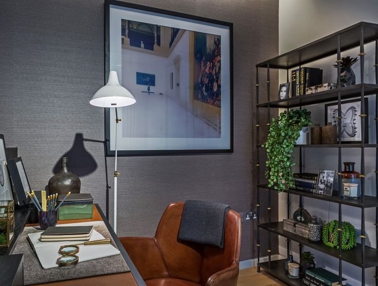 This white floor lamp in hand-rubbed antique brass casts the perfect light over this beautifully accessorised desk with leather inserted top by Michael Northcroft, whilst the Italian leather desk chair adds rich warmth to our design of this eclectric, contemporary Soho apartment study.