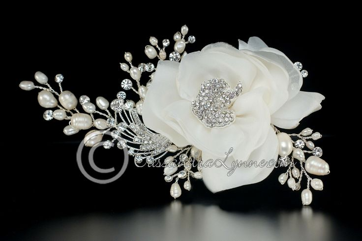 This beautiful clip would impress any bride looking for pearls and a lovely hair flower.